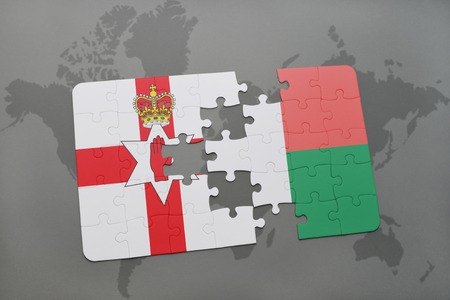 belfast: puzzle with the national flag of northern ireland and madagascar on a world map background. 3D illustration