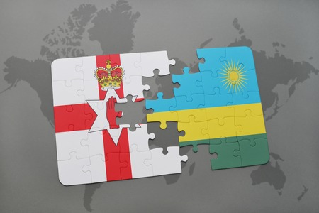 belfast: puzzle with the national flag of northern ireland and rwanda on a world map background. 3D illustration Stock Photo
