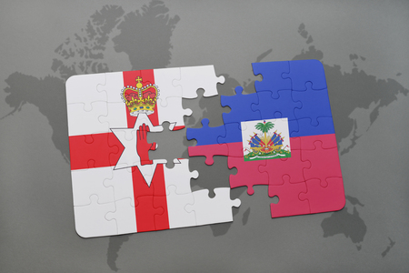 belfast: puzzle with the national flag of northern ireland and haiti on a world map background. 3D illustration