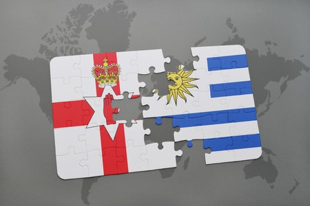 northern ireland: puzzle with the national flag of northern ireland and uruguay on a world map background. 3D illustration