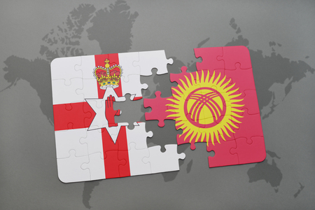 belfast: puzzle with the national flag of northern ireland and kyrgyzstan on a world map background. 3D illustration