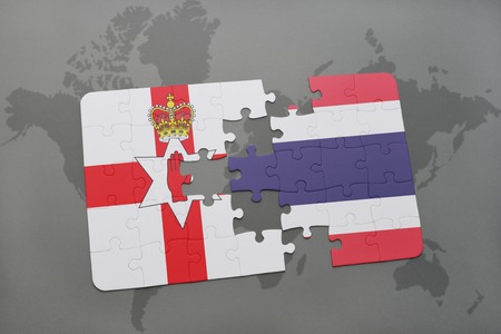 belfast: puzzle with the national flag of northern ireland and thailand on a world map background. 3D illustration