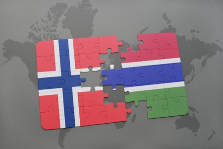 norway flag: puzzle with the national flag of norway and gambia on a world map background. 3D illustration Stock Photo