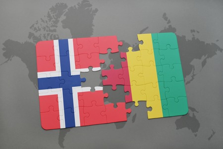 norway flag: puzzle with the national flag of norway and guinea on a world map background. 3D illustration