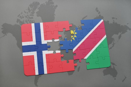 norway flag: puzzle with the national flag of norway and namibia on a world map background. 3D illustration