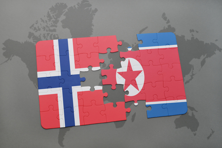 norway flag: puzzle with the national flag of norway and north korea on a world map background. 3D illustration Stock Photo