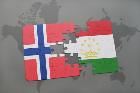 norway flag: puzzle with the national flag of norway and tajikistan on a world map background. 3D illustration Stock Photo