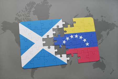 venezuelan flag: puzzle with the national flag of scotland and venezuela on a world map background. 3D illustration