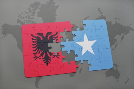 puzzle with the national flag of albania and somalia on a world map background. 3D illustration Stock Photo
