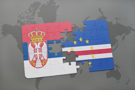 praia: puzzle with the national flag of serbia and cape verde on a world map background. 3D illustration Stock Photo
