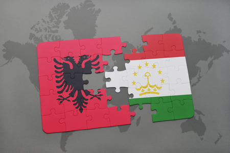 economy of tajikistan: puzzle with the national flag of albania and tajikistan on a world map background. 3D illustration