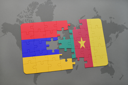 puzzle with the national flag of armenia and cameroon on a world map background. 3D illustration Stock Photo