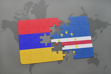 praia: puzzle with the national flag of armenia and cape verde on a world map background. 3D illustration
