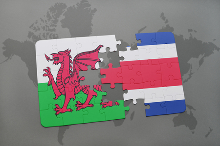 costa rican flag: puzzle with the national flag of wales and costa rica on a world map background. 3D illustration Stock Photo