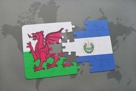 puzzle with the national flag of wales and el salvador on a world map background. 3D illustration Stock Photo
