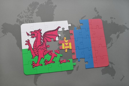 puzzle with the national flag of wales and mongolia on a world map background. 3D illustration Stock Photo