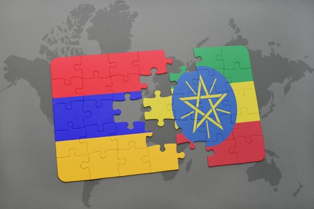 puzzle with the national flag of armenia and ethiopia on a world map background. 3D illustration