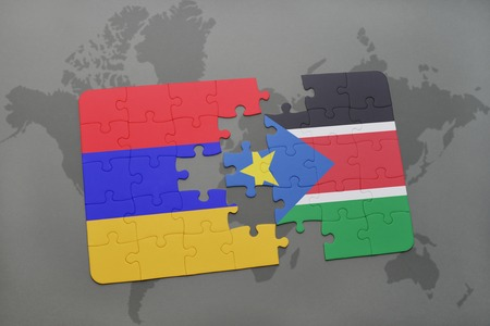 puzzle with the national flag of armenia and south sudan on a world map background. 3D illustration Stock Photo