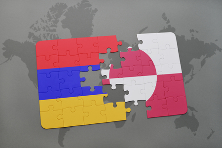 danish flag: puzzle with the national flag of armenia and greenland on a world map background. 3D illustration