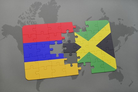 puzzle with the national flag of armenia and jamaica on a world map background. 3D illustration