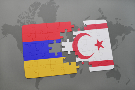 puzzle with the national flag of armenia and northern cyprus on a world map background. 3D illustration Stock Photo