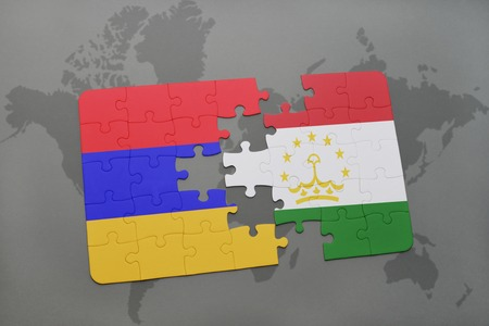 puzzle with the national flag of armenia and tajikistan on a world map background. 3D illustration
