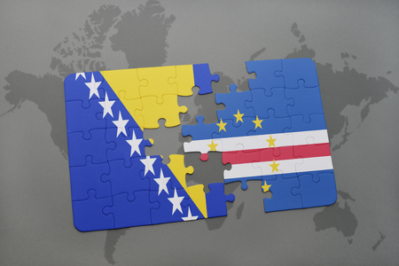 praia: puzzle with the national flag of bosnia and herzegovina and cape verde on a world map background. 3D illustration Stock Photo