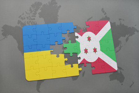 puzzle with the national flag of ukraine and burundi on a world map background. 3D illustration