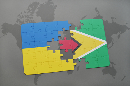 guyanese: puzzle with the national flag of ukraine and guyana on a world map background. 3D illustration