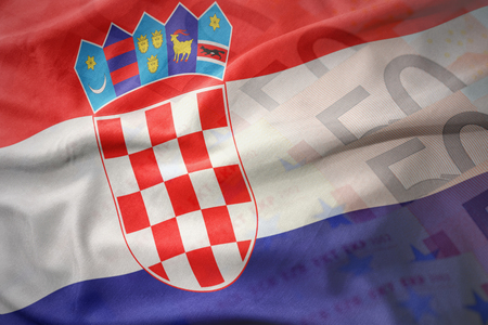 bandera croacia: colorful waving national flag of croatia on a euro money banknotes background. finance concept