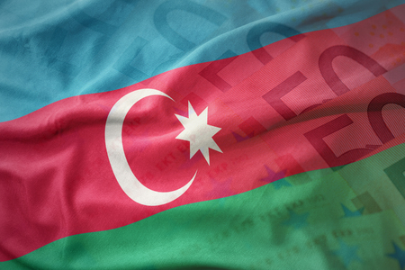 colorful waving national flag of azerbaijan on a euro money banknotes background. finance concept