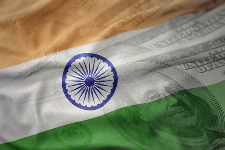 mideast: colorful waving national flag of india on a american dollar money background. finance concept