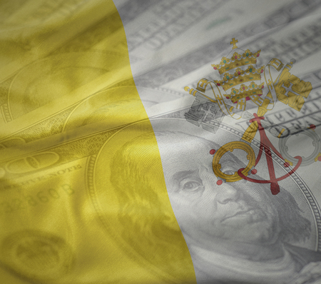 colorful waving national flag of vatican city on a american dollar money background. finance concept