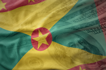 colorful waving national flag of grenada on a american dollar money background. finance concept