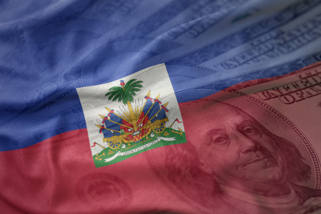 colorful waving national flag of haiti on a american dollar money background. finance concept Stock Photo