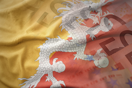 colorful waving national flag of bhutan on a euro money banknotes background. finance concept