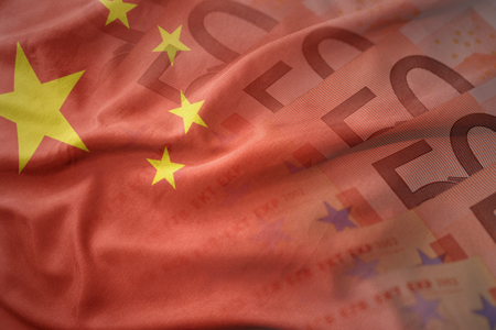 colorful waving national flag of china on a euro money banknotes background. finance concept Stock Photo