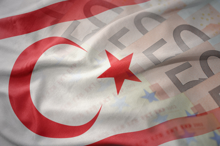 colorful waving national flag of northern cyprus on a euro money banknotes background. finance concept Stock Photo