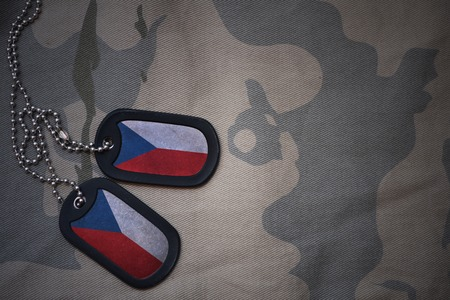 against the war: army blank, dog tag with flag of czech republic on the khaki texture background. military concept
