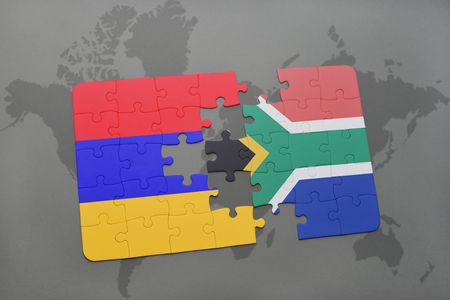 puzzle with the national flag of armenia and south africa on a world map background. 3D illustration