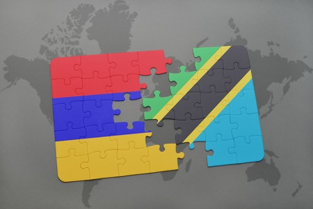 puzzle with the national flag of armenia and tanzania on a world map background. 3D illustration