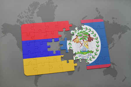 armenian: puzzle with the national flag of armenia and belize on a world map background. 3D illustration