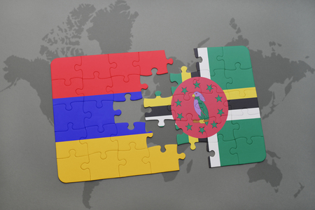puzzle with the national flag of armenia and dominica on a world map background. 3D illustration