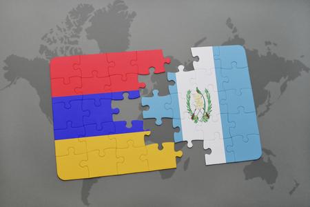 armenian: puzzle with the national flag of armenia and guatemala on a world map background. 3D illustration