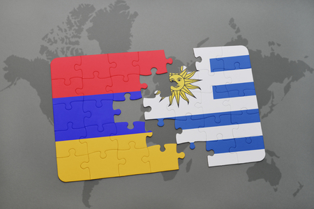 puzzle with the national flag of armenia and uruguay on a world map background. 3D illustration Stock Photo