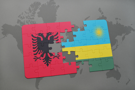 puzzle with the national flag of albania and rwanda on a world map background. 3D illustration Stock Photo