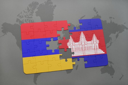 puzzle with the national flag of armenia and cambodia on a world map background. 3D illustration Stock Photo