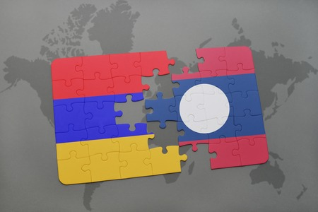 armenian: puzzle with the national flag of armenia and laos on a world map background. 3D illustration