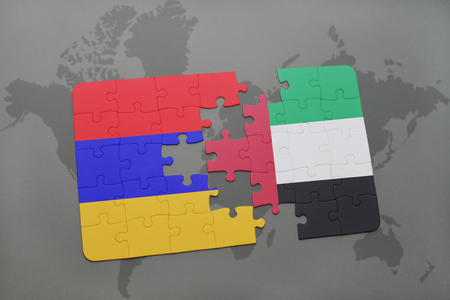 puzzle with the national flag of armenia and united arab emirates on a world map background. 3D illustration