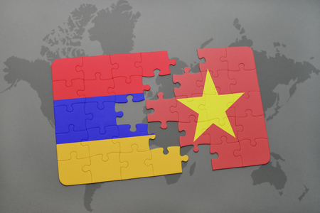 armenian: puzzle with the national flag of armenia and vietnam on a world map background. 3D illustration Stock Photo